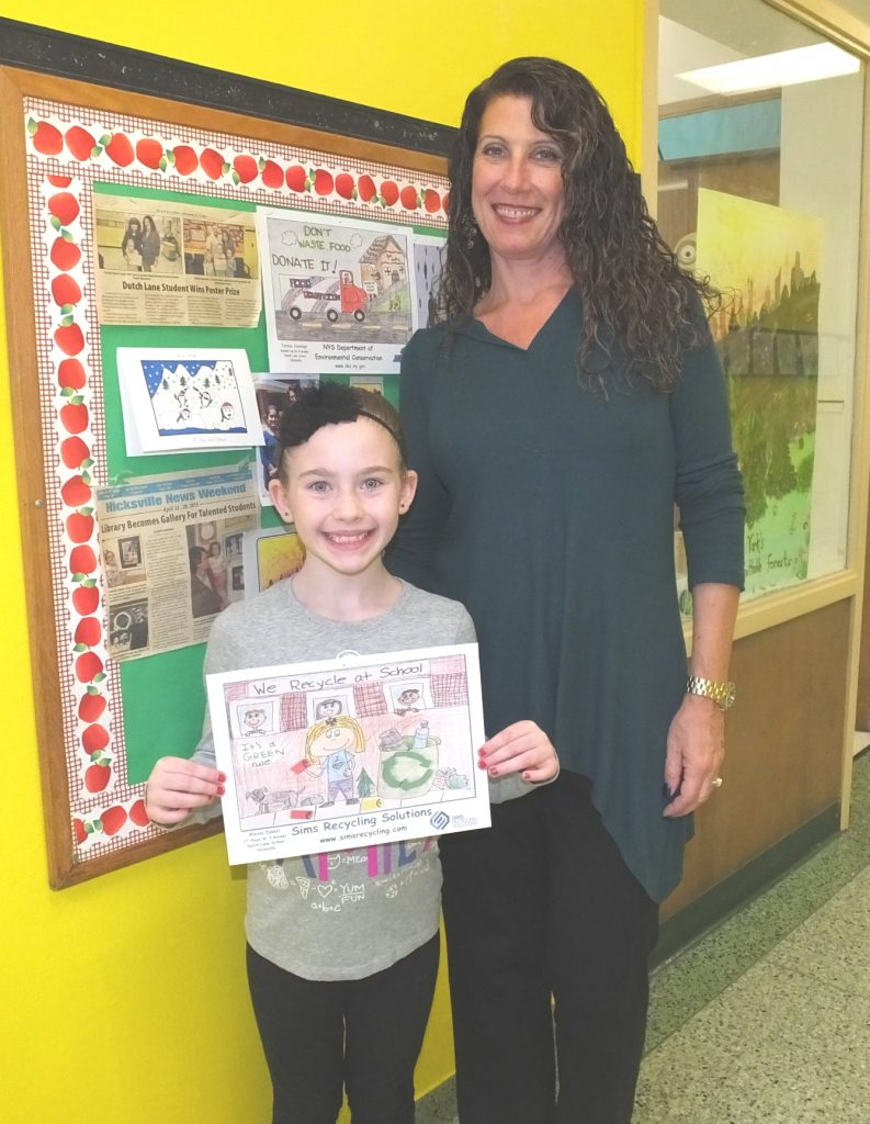 Diana Germinario congratulates 3rd grader, Alexa Danzi on her winning poster.